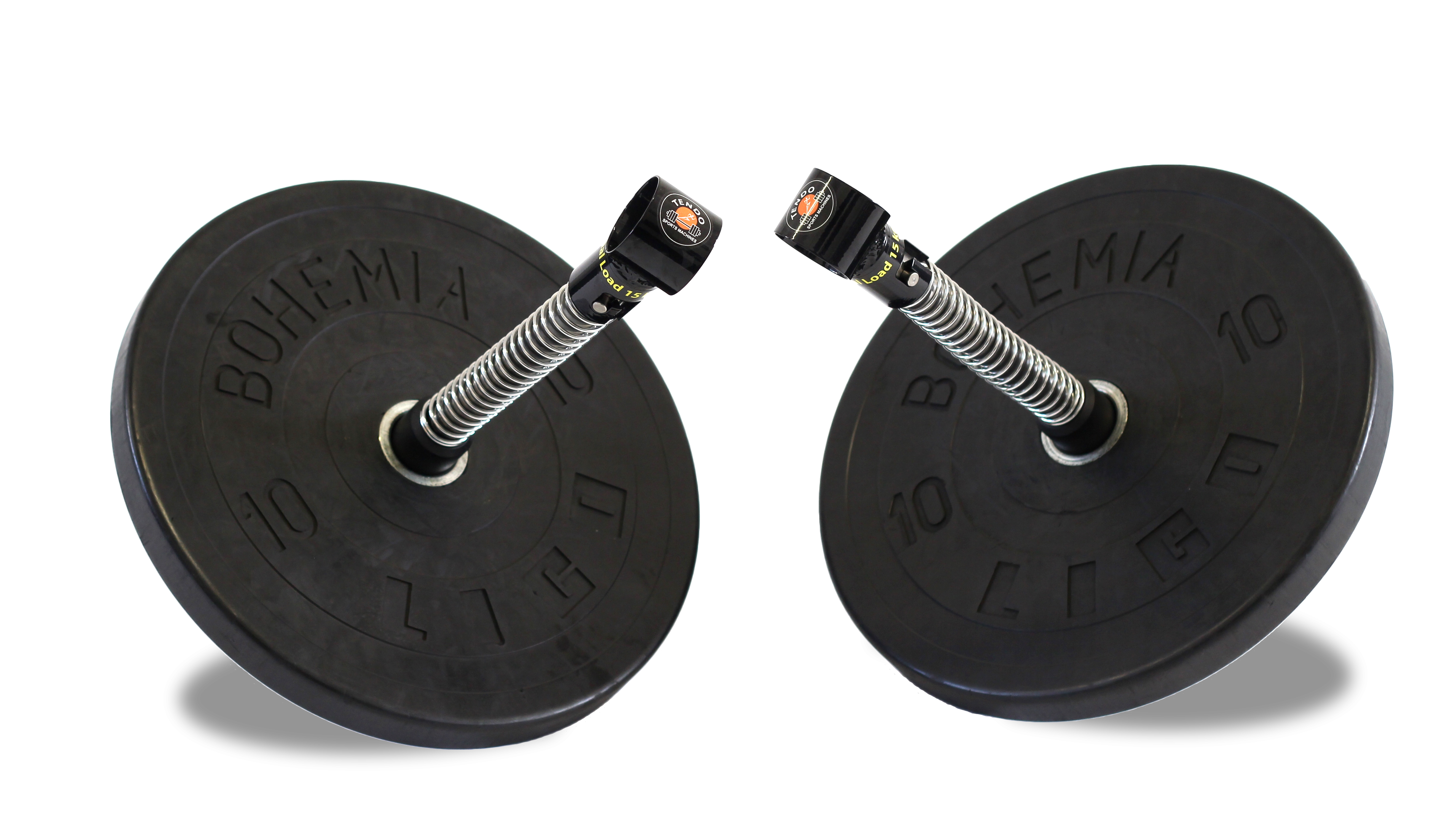 A pair of Tendo barbell destabilisers with weights lying on a ground by Tendo Sport