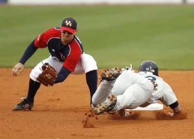 Baseball players catching the ball and sliding into first base - Tendo Sport