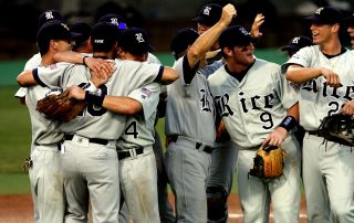 Happy baseball team hugging each other after winning a game - Tendo Sport