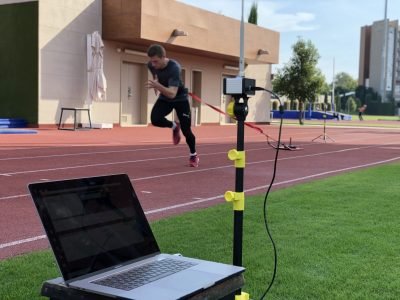 Athlete training sprints on track while his speed in measured with Tendo Sprint System by Tendo Sport