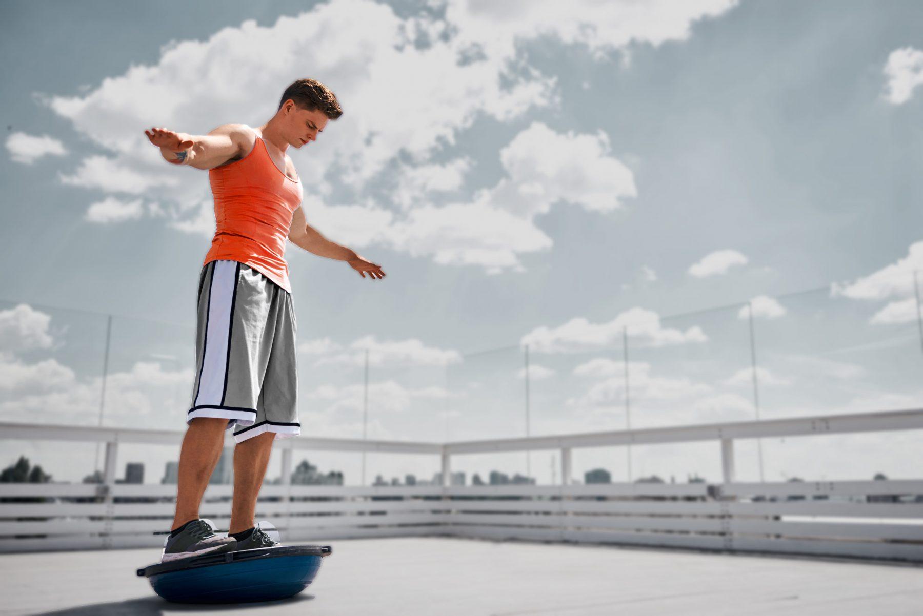 Man athlete balancing on bosu ball vs Tendo Sport's Tendo Barbell Destabiliser